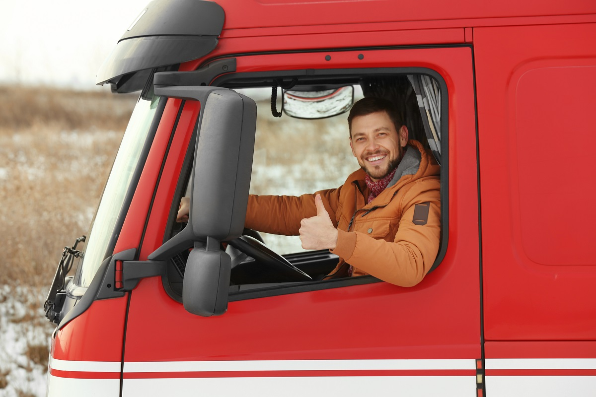 Driver posing inside his red truck