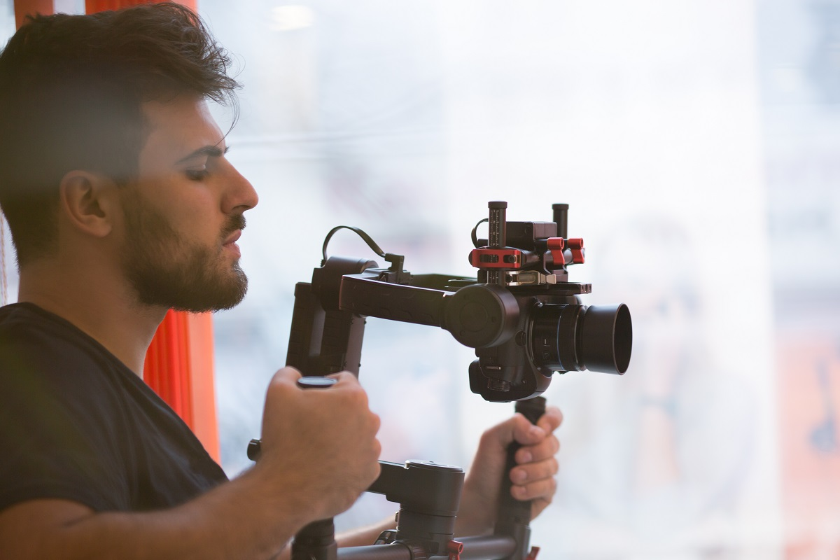 Videographer holding an slr