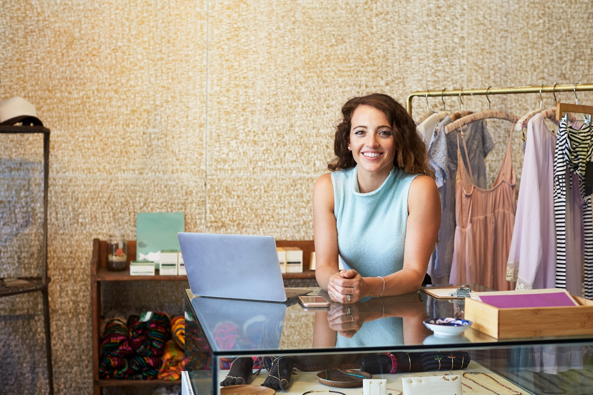 Businesswoman standing behind the counter
