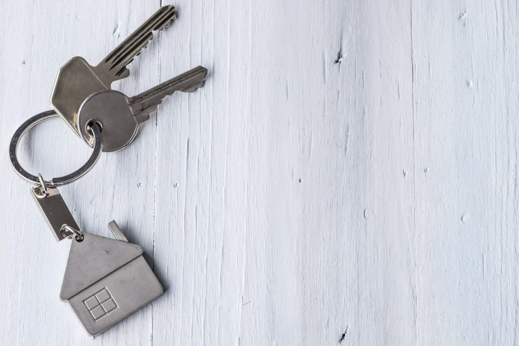 Keys on a white wooden surface