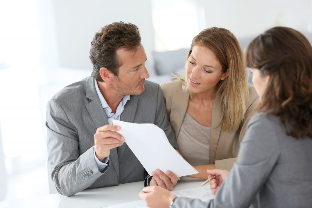 couple looking at their real estate portfolio