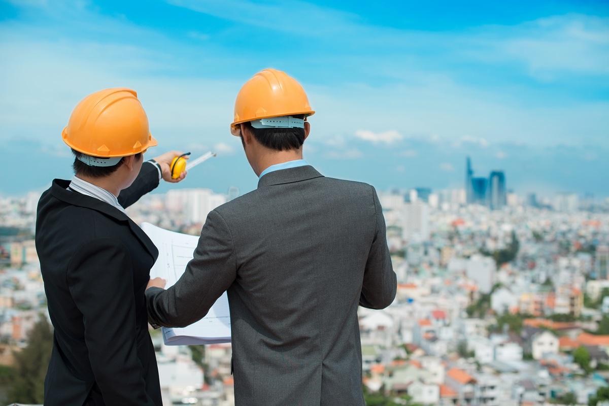 Businessmen in hard hats