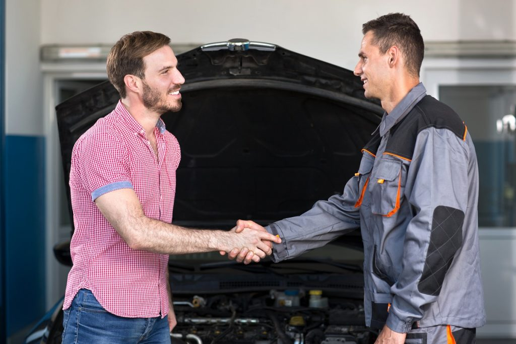 Mechanic and customer handshake