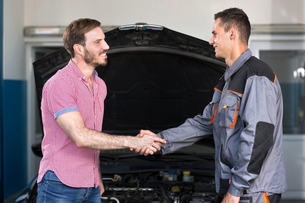 Mechanic and customer handshake