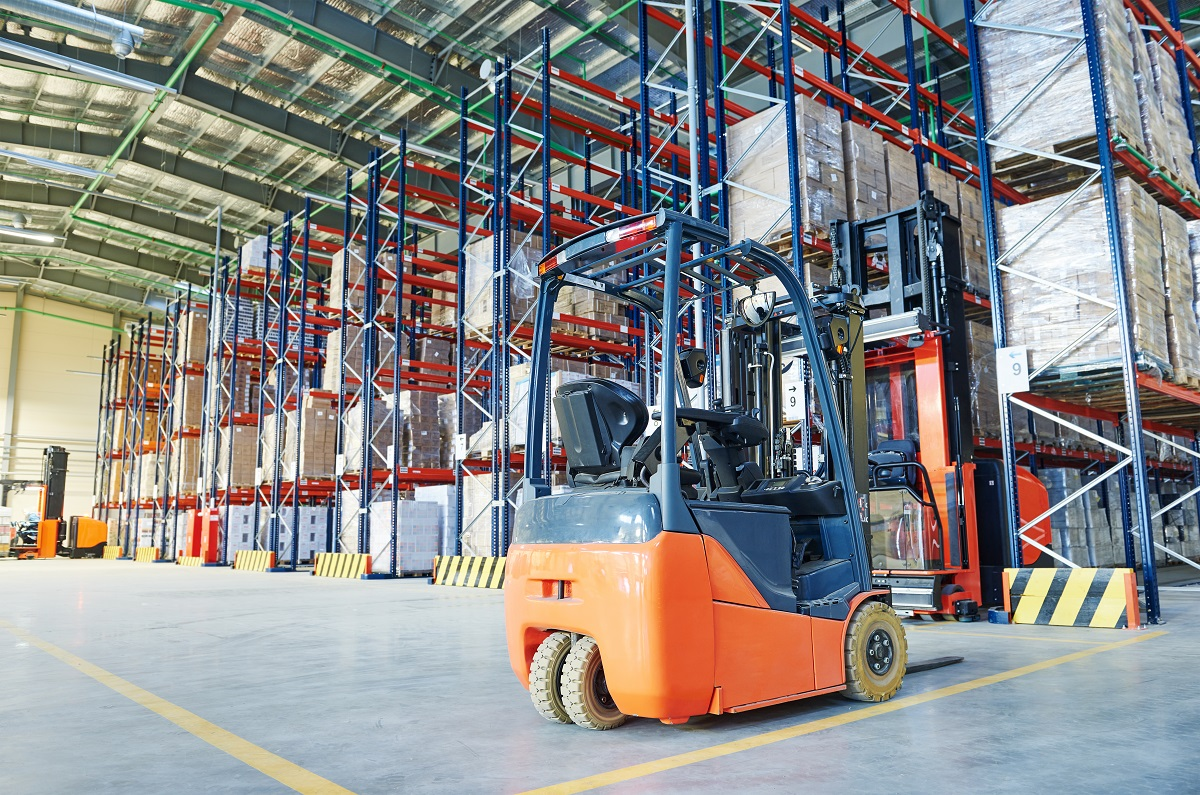 Forklift loader and steel racks inside the warehouse