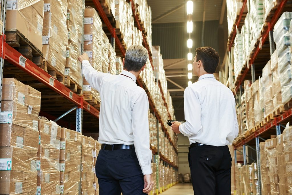 Managers checking the parcels in the warehouse