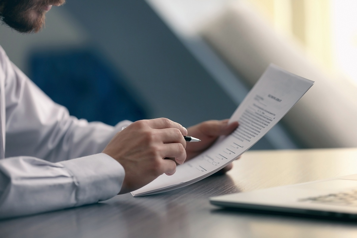 Business broker reading document