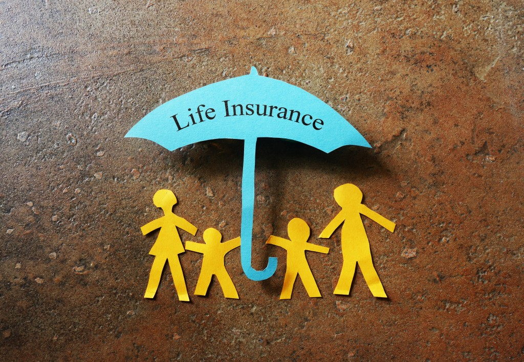 Life insurance umbrella under paper cut family