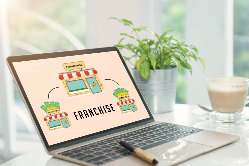Franchising concept shown in laptop monitor