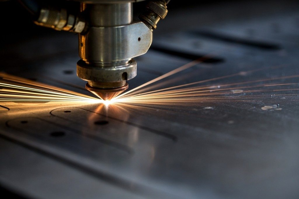 sparks fly from laser