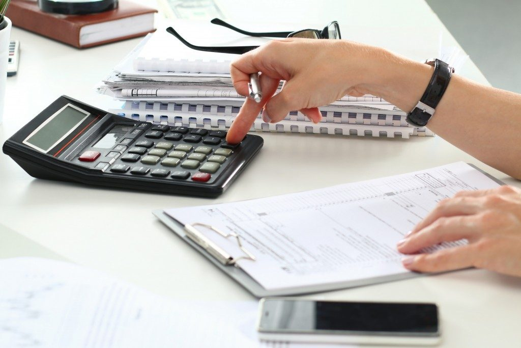 accountant or banker making calculations
