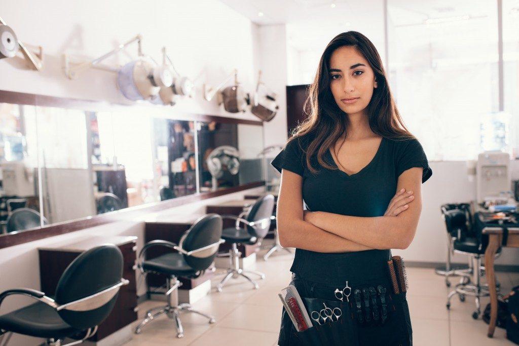 Woman running a hair salon business