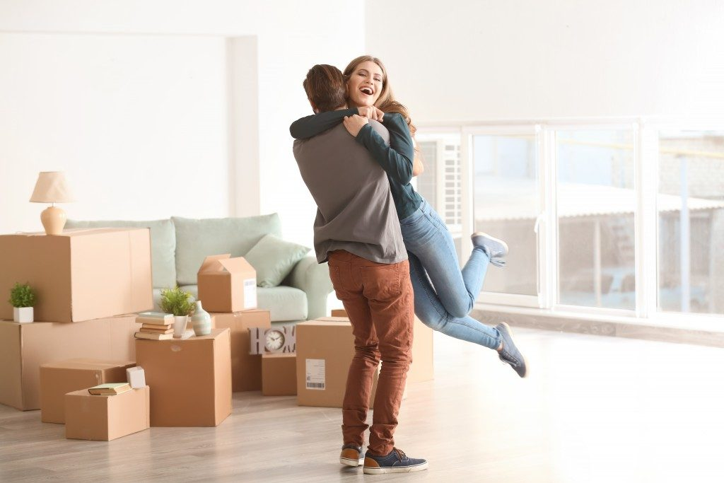 couple hugging around cardboard boxes