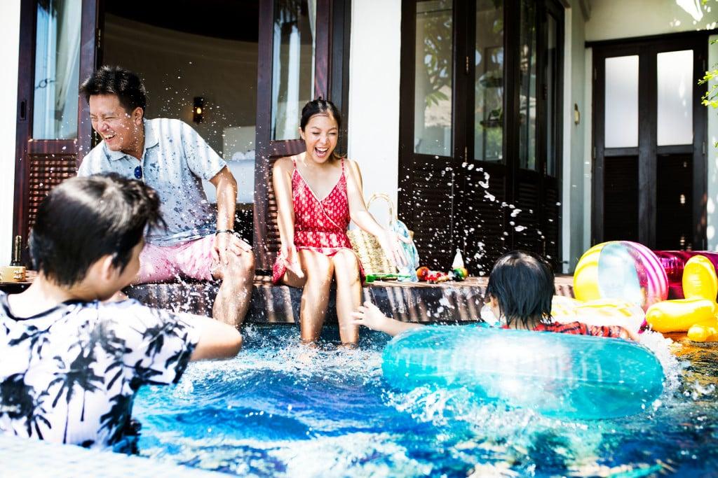 family having fun at the pool